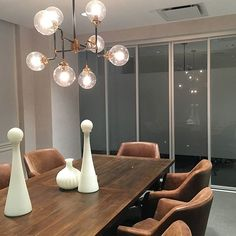 How to make a dining room both stylish + multi-functional? Comfortable furniture, great lighting and sleek sliding doors. Sliding Door Room Dividers, Sliding Door Company, Room Divider Doors, Room Divider Screen, Sliding Doors, Glass Room Divider, Glass Barn Doors, Glass Partition, White Laminate
