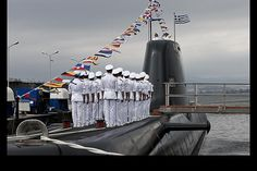 Greek Navy officers salute, during a Pipinos submarine launch ceremony at Skaramanga shipyards near Athens. Greece launched the Pipinos, the first of three German-designed Type 214 submarines after years of delays due to legal and technical disputes. - CSMonitor.com