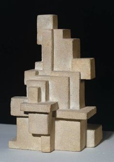 Interrelation of Volumes (Vantongerloo, Georges. 1919) - An abstract sandstone scuplture that would also fall under the style of constructivism because of its use of square and rectangular geometry.