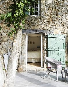 What a dreamy bedroom, in an old stone house