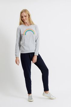 This cute rainbow-print sweatshirt, in 100% organic certified cotton, will brighten up your day.