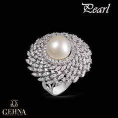 This timeless beauty will make you & your outfit stand out on the auspicious occasion of Navratri! #Pearl #Diamonds #Ring #Jewellery