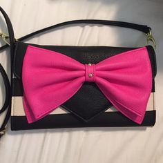 NWOT Betsy Johnson purse PRICE FIRM Adjustable Betsy Johnson black and white striped purse with pink bow.can be cross body or a clutch. I just took the tags off on accident but other than that this cute bag is brand new💓💓💓Offers are always considered! Remember you always get a featured item free with your purchase!❤️ Betsey Johnson Bags Crossbody Bags