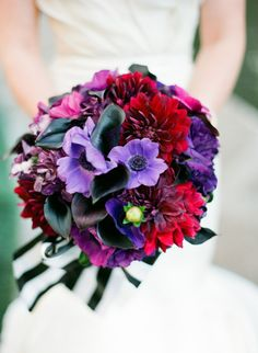 deep jewel tones in this bouquet topped off with black and white stripes Photography by Taylor Lord Photography / taylorlord.com, Planning by Timeless Beginnings / timeless-beginnings.com, Floral Design by DeVinnie's Paradise / devinnies.com