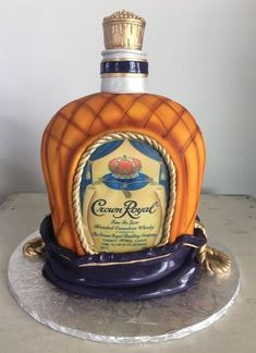 The Groom's Cake - A Brief History & Inspiration — Marrygrams // Consider a jumbo sized version of his favorite spirit (like this Crown Royal bottle) served with a shot on the side. He'll have his cake and drink it too! Crown Royal Cake, Crown Royal Bottle, Crown Cake, Liquor Bottle Cake, Liquor Cake, 21st Birthday Cake For Guys, Birthday Party Themes, Cake Birthday, 36th Birthday