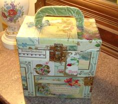 old record case decoupaged with vintage postcards , I won't do this again !