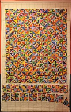 I have to figure this block out.  What a great scrap quilt!