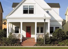 Add color! Encompass by Pella entry doors in wood-grain fiberglass can be finished in your choice of six stain colors or twelve paint colors. #red door