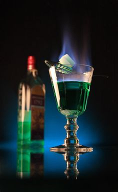 The Bohemian Method of absinthe ritual involves fire, and was not performed in the Belle Époque. Like the French method, a sugar cube is placed on a slotted spoon over a glass containing one shot of absinthe. The sugar is pre-soaked in alcohol (usually more absinthe), then set ablaze. The flaming sugar cube is then dropped into the glass, thus igniting the absinthe. Finally, a shot glass of water is added to douse the flames. This method tends to produce a stronger drink than the French method.