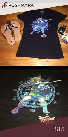 Nintendo's the Legend of Zelda short sleeve shirt! Black short sleeve Nintendo's the Legend of Zelda: Skyward Sword shirt! It's size XL never been worn before! 100% Cotton! Very soft and stretchy!  (Shirt only, shoes & accessories not included) (shoes sold separately) Nintendo Tops Tees - Short Sleeve