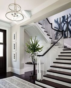 Design by Diamond Custom Homes Inc. gorgeous espresso wood floor stain, tall baseboard and that staircase!