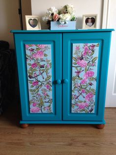 Plain pine unit, restored and upcycled in habitat kingfisher paint and decoupage in graham and brown wallpaper.