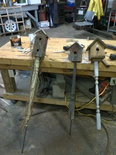 Another Pinner Wrote: Reclaimed Barn board Birdhouses. The post is made from antique table legs. I just love the one on the right with the vines. Made in WI USA by my dad! Garden Crafts, Garden Projects, Home Projects, Garden Art, Spindle Crafts, Wood Crafts, Bird House Feeder, Bird Feeders, Bird House Plans