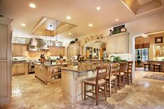 Wow. I love this kitchen. I love the layout, the 2 islands (1 with barstools), windows above the cabinets, the colors...