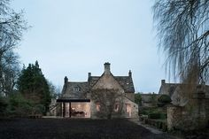 Contemporary glass extension to the classic Yew Tree House 17th Century British Cottage Gets a Glassy Modern Extension