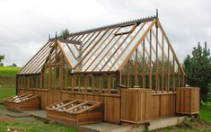 wow... what a greenhouse...love the cold frames on the sides too!
