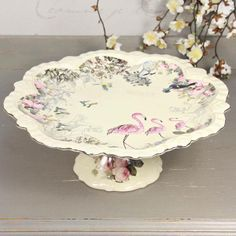 Flamingo Cake Stand *a little pricey for a $10.00 cake but it sure would make a table setting smile*