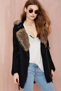 Awesome black anorak featuring a faux fur hood and drawstring waist.
