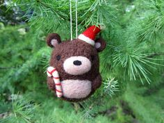 ~Made to Order~  Add a little cuteness to your Christmas tree with this adorable needle felted bear ornament. He comes wearing a Santa hat and