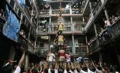 Hindu devotees, try to form a human pyramid to break an earthen pot filled with honey, milk and curd, as part of festivities to celebrate Janmashthmi, or the birth anniversary of Lord Krishna, in Mumbai, India, Sunday, Aug. 24, 2008. (AP Photo/Rajanish Kakade)