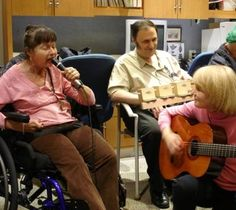 Caregiver Humor - Recreational therapist, Christina Conroy pictured here leading a music therapy session   finds humor in a nursing home.