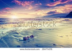 Amazing morning sun over the sea with overcast sky. Black Sea, Crimea, Ukraine, Europe. Beauty world. Retro style filter. Instagram toning effect.  - stock photo