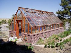 Custom 12 x 24 Tudor Freestanding garden greenhouse on brick base