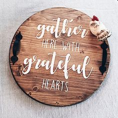 gather here with grateful hearts Wood lazy susan. Stained brown with black handles. Lettering is white. Sealed. SIZE: approximately 14.5 round. I ship USPS.