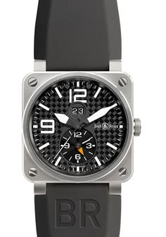The Bell & Ross Instrument BR03-51 GMT. Automatic winding with big date function and second time zone. White hands and numerals. Featuring a 42mm Titanium case with carbon fiber dial on a black rubber