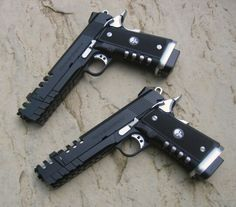 Twin Para Ordinance 1911 with ported barrels and punisher grips
