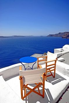 Oia, Santorini Greece - I would like to be there right now with a glass of wine.