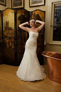 Suzanne, beaded French lace strapless wedding gown. #CHANTICLEER