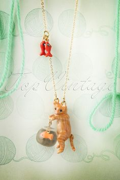 """Show your love for animals with this50s Kitten Eyeing the Goldfish Necklace!  Just like the cute kitty cat shows its """"love"""" for the little gold fish,Les Néréides shows its affection for our four-legged friends by donating an amountgathered by the sale of this exclusive collection to refuges and shelters striving for the protection of abandoned, endangered or sick animals. The necklace iscovered in 14K fine gold and the adorable cat is made from hand-enam..."""
