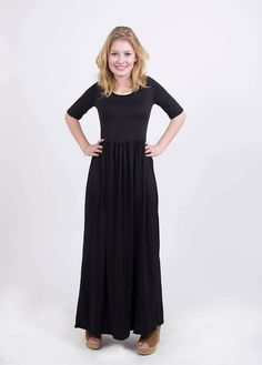 Looking for that perfect basic dress to wear with everything this fall and fitting for any day of fall? Our Black 3/4 Sleeve Maxi Dress is exactly what you need. With its practical 3/4 sleeves, empire cut and maxi length, this will be your go-to dress thi