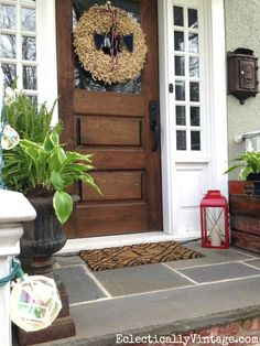 What a fun summer porch filled with such creative decorating ideas including a stack of old soda crates as a planter and love that amazing wreath and red lantern both from HomeGoods eclecticallyvinta. Porch Doors, Wood Front Doors, Front Door Decor, Wooden Doors, Front Porch, Front Entry, Entry Doors, D House, House With Porch