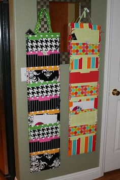 DIY hanging folders.  I love that you can just hang these on a nail or one of those removable plastic hooks.  You do need  a sewing machine, though.