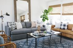A cozy eclectic blue living room designed by House of Jade Interiors recreated for less by copycatchic luxe living for less budget home decor and design room redo Cozy Eclectic Living Room, Coastal Living Rooms, Living Room Pillows, Living Room Furniture, Living Room Decor, Sofa Throw Pillows, Apartment Furniture, Furniture Stores, Apartment Living