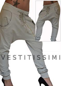 Pantalone donna sportivo colore grigio con tasche, lacci in vita e cerniera obliqua