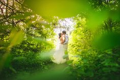 dreamy photo of bride and groom in the woods - sam hurd
