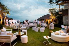 Our party setup for an event at Seseh Beach Villas. Our round ottomans, poufs, Capp Chairs, modern white tables all with the gold theme of the evening accents. #Bali #Events #furniture #hire #Baliultimate