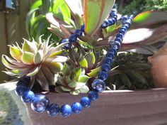 This deep blue necklace is made from Egyptian Lapis Lazuli stones and sea shell pearls. Has an s toggle for security.