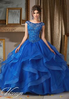 Stunning and elegant, Mori Lee Vizcaya Quinceanera Dress Style 89117 is sure to light up the room during any girl's Sweet 15 party. Made out of organza, this Quince dress features a cap sleeved sheer