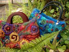 repinning another photo of my work 2 of my freeform purses....my 'never too many handbags' book is now available in PDF form via my website http://www.knotjustknitting.com ;-)