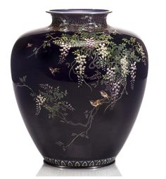 A cloisonné enamel ovoid vase By the workshop of Hayashi Kodenji, Meiji period (late 19th century) Worked in silver wire and colored enamels with birds amid blossoming wisteria vines against a midnight blue ground, the neck decorated with flowering paulowia on a karakusa ground and the foot encircled by a garland-lappet band, silver edge bands, an inlaid Hayashi Kodenji mark on the base
