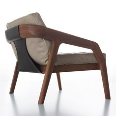 Friday Lounge designed Formstelle for Zeitraum.  The subtly formed wooden frame of the chair  has a back section of leather with a design reminiscent of a pattern cut. Lounge chair with frame in solid wood available in oak or American walnut.  Eco-friendly, made from sustainable wood.