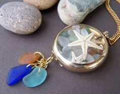 Sea glass and star fish in a vintage pocket watch case makes a gorgeous pendant necklace! Stone Street Studio