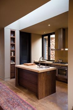 Linear Skylight and Floor to Ceiling Pantry Door | via TRÈS CHIC Blog