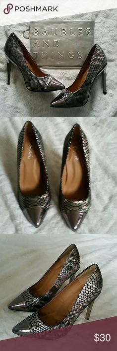Pewter snakeskin pumps These shoes are to die for and I'm so sad I don't have them in my size!! Beautiful snakeskin that picks up and reflects irrodescent colors.  Pewter/silver toe and heels.  Heel height is 3.75 inches.  NIB. Also available in gold!! Shoes Heels