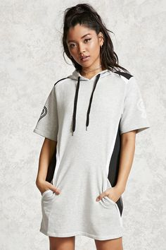 "A marled knit hooded dress featuring a drawstring neckline, stretch-knit contrast mesh panels, slanted pockets, a ""1991"" graphic on the short sleeves, and a ""Property of New York City Gym"" graphic on the back."