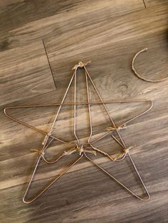 star according to how much twine you want wrapped around it. My stars are not completely covered. Wire Hanger Crafts, Wire Hangers, Christmas Star, Simple Christmas, Xmas, Christmas Mantles, Christmas Christmas, Christmas Ornaments, Christmas Projects
